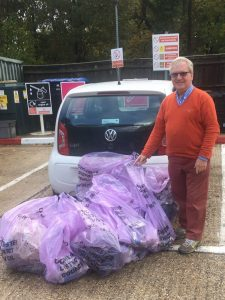 Councillor John Miller with bags of litter